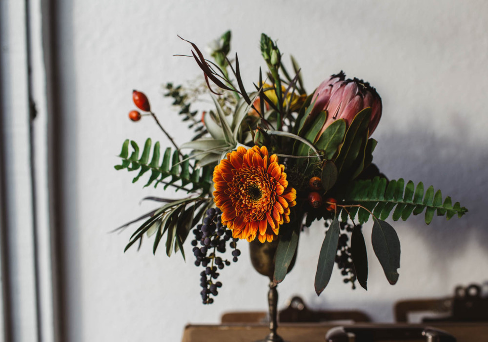 redding florist: centerpiece with berries, fern and proteas