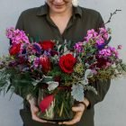 holding-xtra-large-valentines-day-flowers