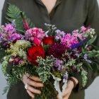 holding-medium-vday-flowers