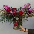 holding-xtra-large-valentines-flowers